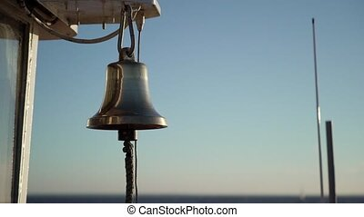 Bell on a ship at sunset