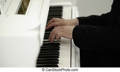 Man playing piano - Man playing music on piano