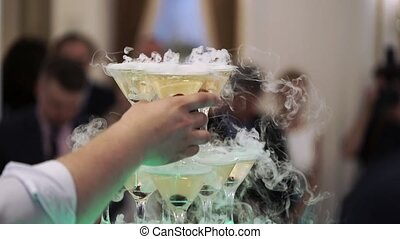 People takes glasses with champagne from pyramid