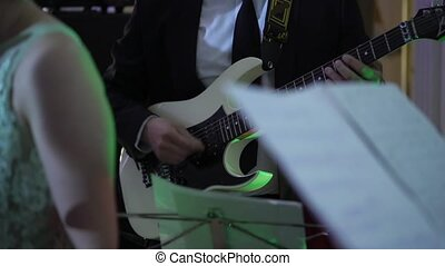 Guitarist in music band at concert