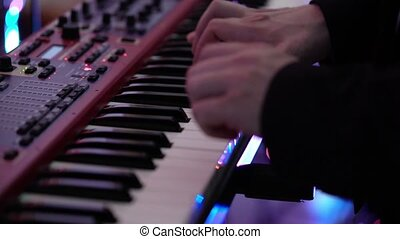 Man playing music on piano keyboard