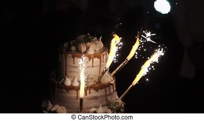 Celebration cake at the party with fireworks slowmotion