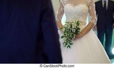 Bride with bouquet at wedding ceremony - Bride with bouquet...