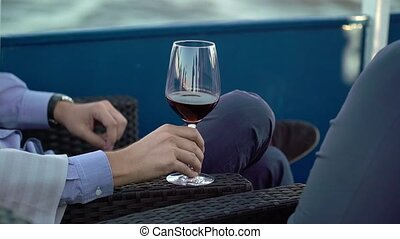 Man with glass of red wine at the ship