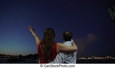 Man and woman watching colorful firework colorful firework...