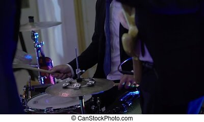 Drummer playing percussion at concert
