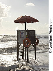 Sunset view of a lifeguard tower at sunset time in Versilia,...