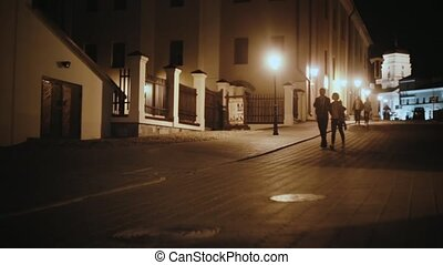 Young hipster couple hugging, walking in the city centre in...