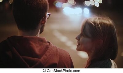 Young beautiful couple walking in the city centre in...