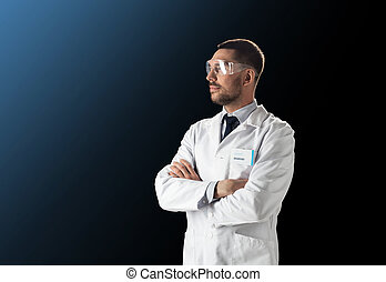 scientist in lab coat and safety glasses - science,...