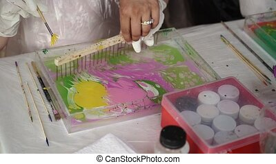 People painting turkish traditional pictures closeup