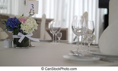 Flowers composition on wedding table indoors