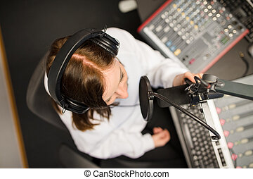 Directly Above Shot Of Radio Jockey Using Microphone And...
