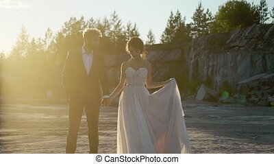 Young lovely couple walking at sunset slowmotion