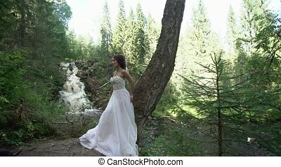 Young couple embracing near waterfall