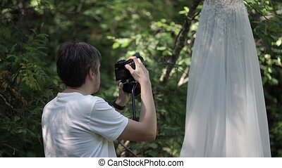 Young man shooting video at the wedding