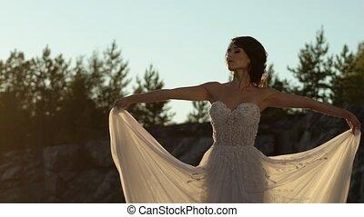 Bride circling and waving dress slowmotion