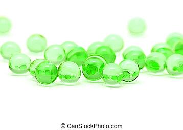 Transparent green capsules