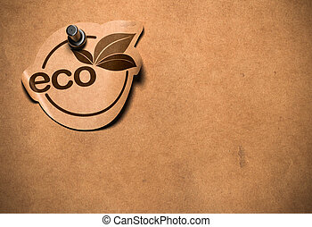 eco sticker fixed by a pushpin on a bronw paper withe copy space