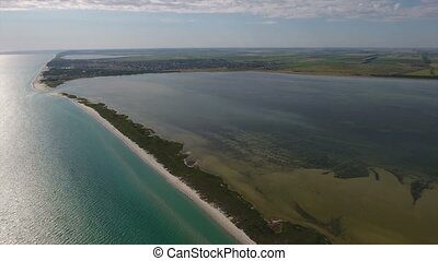 Aerial shot of a beautiful sunset over two long islands in...