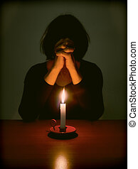 Woman and candle. Prayer, mercy, faith concept. - Religious...