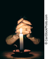 Female hands and candle. Prayer, mercy, faith concept. -...