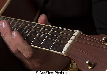 Playing Guitar Hand - Young man playing clasic guitar with...