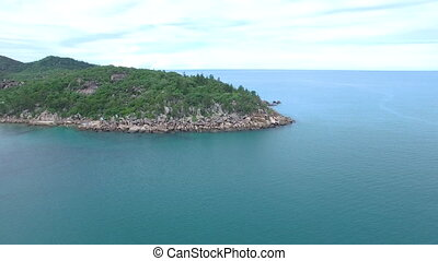 Ocean and island forest - A wide shot of an island forest...