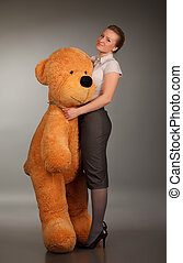 girl with funny toy bear