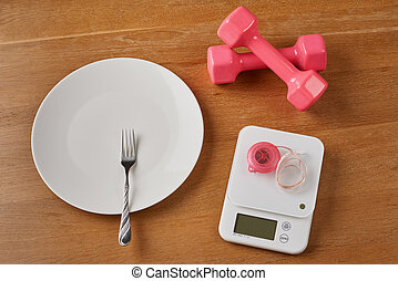 scales and empty plate with dumbbells - white food scales...
