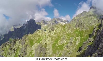 timelapse view of clouds moving over mountains - timelapse...