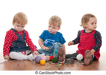 Threads of children friendship - Three toddlers are playing...