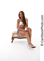Young sexy ethnic black African-American woman in denim shorts