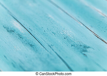 wooden planks with chalky paint is getting sanded for old...