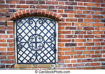 The wall with window of broken and abandoned red brick...