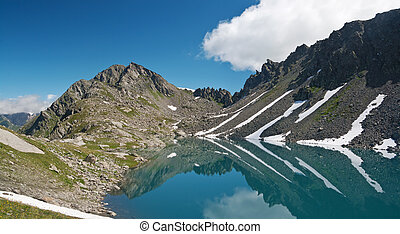 Pietra Rossa Lake, Italian Alps - summer view of Red Stone...