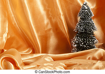 a Christmas decorations on a fabric background