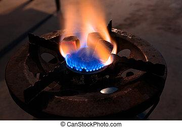 Charcoal for shisha on a gas burner