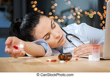 Tired exhausted scientist sleeping at her workplace