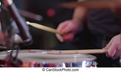 Man playing the drums at a concert close up. - Man playing...