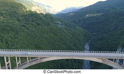 Aerial view of Durdevica Tara arc bridge in the mountains,...