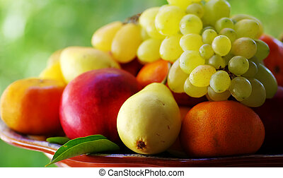 fresh fruits on the green background