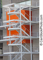 Fire escape ladder on the side of a new building