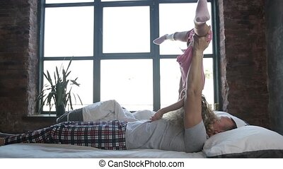 Dad doing dynamic gymnastics with a child - Loving dad and...