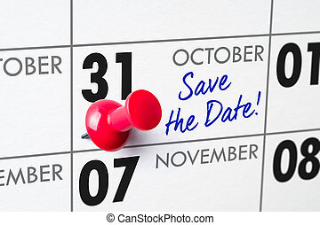 Wall calendar with a red pin - October 31