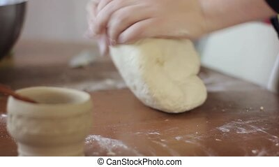 woman hands kneading dough on table. cooking food on a kitchen