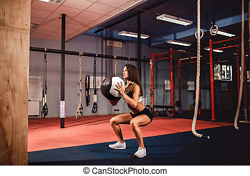 Woman training with functional gymnastic in the gym