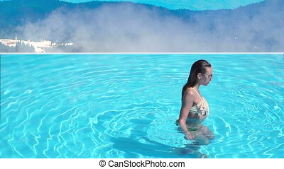 sexy wet young girl in the pool in the mountains in slow...