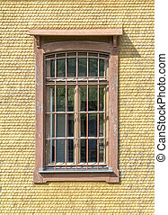 historic house facade with window - historic wood paneled...