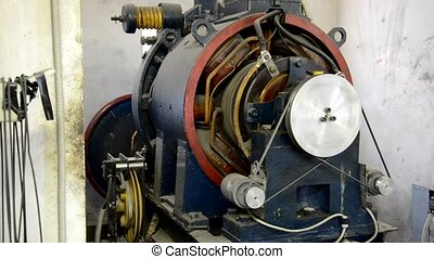 View of old elevator engine in action - Old elevator engine...